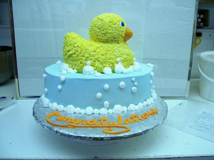 [Image: Baby shower cake with little duck]